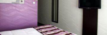 Une chambre à l'hôtel de Belfort